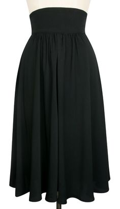 The 40's Skirt is perfect for cooler weather in classic black heavy-weight rayon. Inspired by styles of the 1940's, this vintage-inspired design features gathers to the front, a high waist, and is knee-length with an invisible side zipper. With a retro design and pockets, this A-line skirt is incredibly fun and easy to wear. This versatile piece is the perfect separate to dress up any top. Pair the 40's Skirt with the Annie Blouse for the retro look we all love! #trashydiva40sskirt