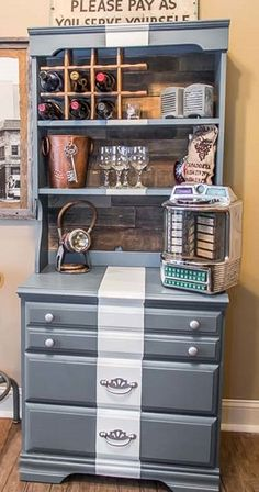 With a fresh coat of paint and a few accessories, Beth, of the blog Unskinny Boppy, converted a 1980s chest of drawers into a wine-bar cabinet with a reclaimed wood back and old soda-bottle crate turned into a wine rack. We have her step-by-steps.