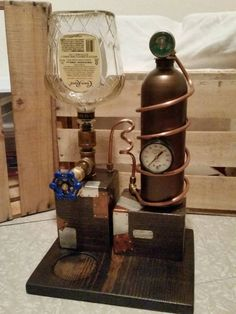 This is a custom made Liquor Dispenser made to look like a moonshine still or steampunk style. It can hold just about any 750ml or 1lt bottle