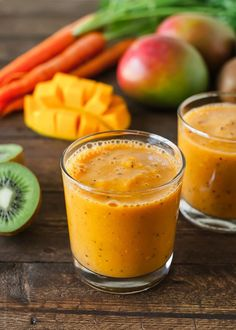 Mango + Chia powered smoothie packed with fiber, folate, chlorophyll, phytonutrients, vitamins, and flavor!  In a high-powered blender, mix 1/2 organic mango with skin, 1/2 organic kiwi with skin, 1 carrot, 1 handful spinach, 1 Tbsp. Chia seeds and 1 cup ice water. Enjoy!