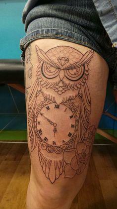 Owl tattoo with clock.
