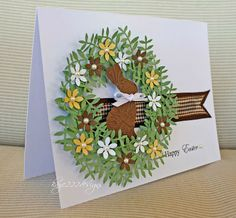 lovey handmade Easter card ... wreath of punched leaves and flowers ... chocolate die cut bunny ... great design ... lots of dimension ...