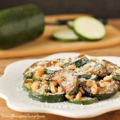 Sauteed Zucchini with Walnuts is my family's FAVORITE side dish. You have to try this quick and easy zucchini side dish topped with Parmesan cheese and crunchy walnuts!! I promised another zucchini post this week, so here it is! May I present to you….Sauteed Zucchini with Walnuts! Quick enough for a busy weeknight, yet elegant … Raw Food Recipes, Vegetable Recipes, Cooking Recipes, Healthy Recipes, Vegetable Sides, Veggie Food, Healthy Eats, Healthy Foods, Vegetarian Recipes
