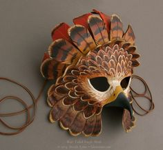 In a similar style to my fantasy golden eagle mask, this one is inspired by the plumage of a red-tailed hawk, complete with a crest of rusty tail feathers. Hand-carved and shaped leather with . Larp, Mascara Papel Mache, Tiki Maske, Eagle Mask, Cardboard Mask, Feather Mask, Bird Masks, Marionette, Red Tailed Hawk