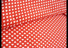 http://en.dawanda.com/product/99562491-quilting-cotton-fabric-white-hearts-on-red