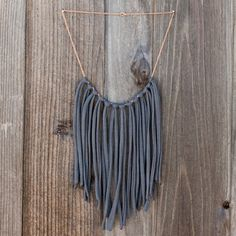 DIY 15 Easy Ways to Turn T-Shirts into Jewelry | Brit + Co. = made a tassel necklace like this last summer for my daughter