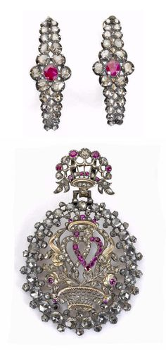 An 18th-19th century ruby and diamond pendant and earring suite. The oval pendant with central entwined heart motif amongst a basket of flowers, suspended from a giardinetto surmount, set throughout with rose-cut diamonds and vari-cut rubies, accompanied by a pair of oval-cut ruby and rose-cut diamond half hoop earrings, mounted in silver and yellow gold, closed-back settings throughout, pendant length 6.2cm, earring length 3.3cm, fitted case