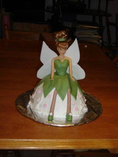 I had fun to decorate this barbie into a tinker bell