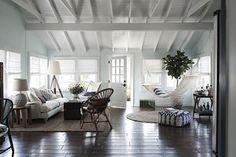 love the dark floors, white walls & ceiling, the front door & the hammock - Indoor Hammock Sweden Loft Remodelista