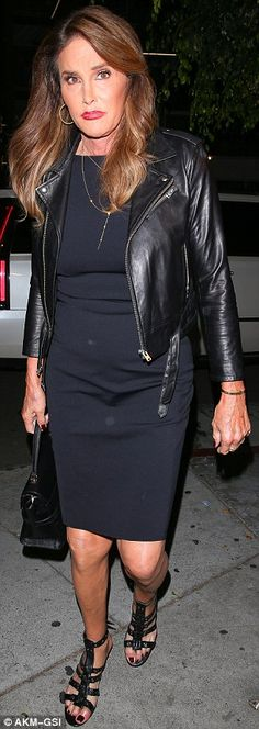 Chic style: Caitlyn Jenner looked great in a navy dress with a black leather jacket and sandals