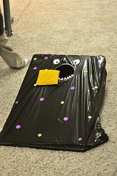 """Feed the monster"" bean bag toss for a monster party..."