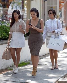 Kim Kourtney  Kris arriving at the Dash store in Southampton, NY