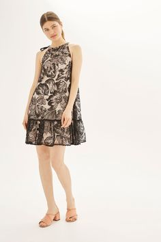 Channel a '60s style with this tie neck swing lace dress in black with nude lining underneath.