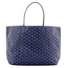 The Goyard tote bag carried by Olivia, is shown in its signature chevron fabric made of a combination of cotton, linen and hemp . The French company, started in 1863, is known for its luxury luggage.  Traditionally, the bags came in black, but the company now offers it in yellow, green and blue.