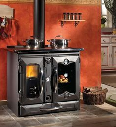 Fancy - La Nordica Wood Burning Cooking Stove I like this in a separate outdoor kitchen Wood Burning Cook Stove, Wood Stove Cooking, Kitchen Stove, Homey Kitchen, Kitchen Cook, Cooking Lamb, Cooking Pasta, Stove Fireplace, Fireplace Design