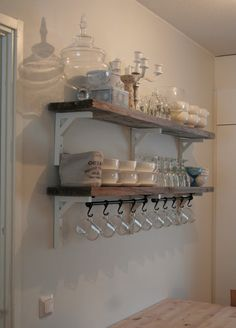 IKEA shelf brackets, rail with hooks for hanging...Love the look of how they have this all stacked