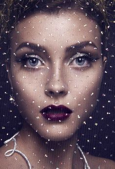 """Celestial Christmas: """"A softly lit silver eye paired with a deep lip has something of a cosmic debutante feel to it,"""" Montano explains. """"The key is using extra foundation to ensure the skin is flawless and radiant, and to use a slightly darker shade in the eye socket and underneath the cheekbones for definition."""""""