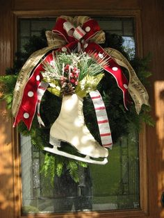 I'm really loving the skates this winter! And the music sheets, so this ribbon is perfect on this wreath. =)