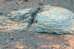 Pancam false-color view acquired on sol 3066 of fine-scale layering in the Whitewater Lake locality. Veneers have been resistant to wind erosion and enhanced the layered appearance of the outcrop. Layers are typically several millimeters thick.
