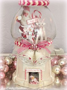 gumball machine filled with vintage cute stuff and embellished with same.  Love it!
