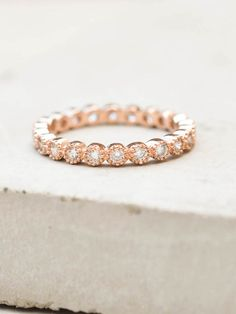 This eternity band Ring is made of gold plated brass and AAA Cubic Zirconia set in a bezel setting. Stones are not glued in, they are set in the metal just like fine jewelry. This ring looks great whe