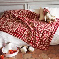 Plaid tricoté en laine rouge et blanche, motifs de Noël - Marie Claire Idées