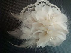 floral and feather fascinator.
