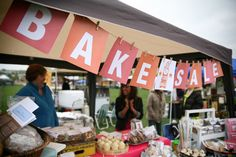 Bake Sale banner on twine with clothespins. Could wrap ends around command hooks so the walls don't get damaged.