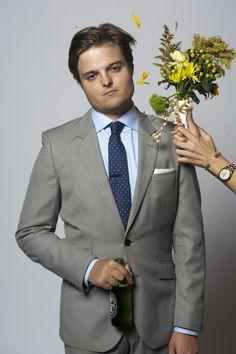 Light grey suit, light blue shirt, blue tie
