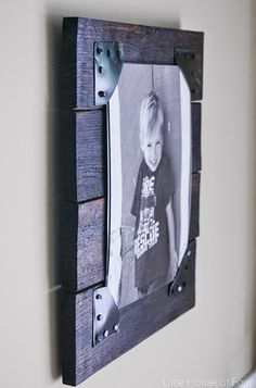 Turn old pallets into the perfect rustic picture frames! #pallets #palletprojects #rusticdecor - Little House of Four