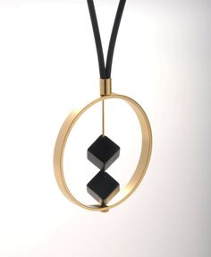 2 DARK pendant. A large gold ring with 2 black onyx , attached to a black leather necklace.. $79.00, via Etsy.