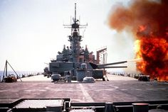 Battleship Wisconsin firing her turret no. 3 guns against Iraqi positions in southern Kuwait during Operation Desert Storm 6 February 1991.