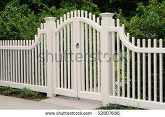Elegant wooden gate and fence on house entrance by Jorge Salcedo, via ShutterStock