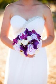 Purple calla lilies, lavender roses, purple orchids with 3 white roses