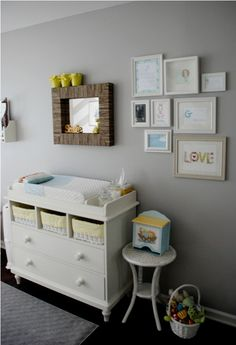 pull out baskets in the changing table. Also, like how they used a plant stand for a little table.