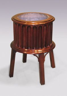 OnlineGalleries.com - A George III period mahogany drum-shaped Jardiniere.