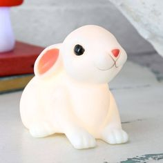 Let this ultra-adorable baby bunny night light, from the Lisa Angel Homeware Collection, will whisk your little ones into a wonderfully peaceful slumber.With a twitch of his cute little nose and a flick of the switch underneath, this sweet white bunny night light will stop your children hopping out of bed when they're afraid of the dark. The white LED light inside this adorable crouched rabbit shaped night light adds a warm comforting glow to your little ones room. An innovative children's…
