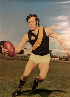 Francis Bourke, Richmond star in a lace up footy jumper. Richmond Football Club, Rugby Men, Tigers, Jumper, Running, Sport, Yellow, Lace, Sports