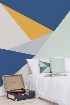 Combining sleek lines with muted colours. This geometric wallpaper design is a stylish and contemporary choice for your walls. It looks great with modern bedroom settings looking for an accent wall that's completely unique.