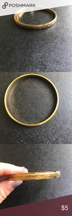 Gold Bangle Heavy gold colored bangle with a zigzag pattern along it. From my grandmother, not real gold but heavy and pretty, especially if you have other bangles to go with it. Monet Jewelry Bracelets