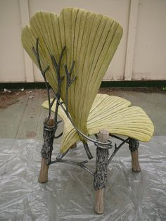 "Chair by Ross Yedinak. WOW! More of his work is on flickr. Stunning. His bio reads: ""Caterer and personal chef. Faux Bois artist sculpting concrete furniture, fencing, pots and planters."""