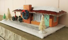 """Get Kate's pattern for a mini midcentury """"putz"""" house -- this one is a retro hip-roof ranch house similar to her own 1962 ranch house. Retro Christmas, Christmas Bells, Christmas Home, Christmas Decorations, Coastal Christmas, Paper Decorations, Holiday Ornaments, Christmas Projects, Holiday Crafts"""