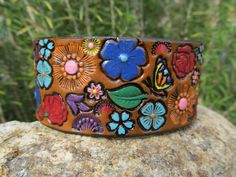 Hand Painted Tooled Leather Bracelet Cuff - Wide - Colorful flowers with hidden butterfly. $19.95, via Etsy. - http://www.etsy.com/listing/109479800/hand-painted-tooled-leather-bracelet?ref=correlated_featured