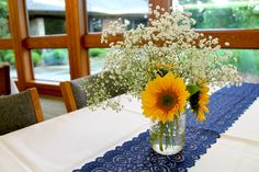 Gold and navy, sunflowers, baby's breath and lace! Perfect for a Kansas wedding in May! #prairiegardenwedding #dyckarboretum #kansaswedding