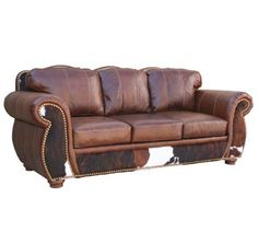 want a cowhide couch similar to this with deep red walls