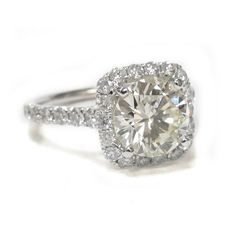 LOVE the square cut.   Bomi's Square Halo Engagement Ring with 2.16ct Center Diamond