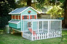 """When we first saw this brightly painted coop we only had one question--€""""can we move in? With colorful shutters and a picket fence, these lucky chickens live in high style."""