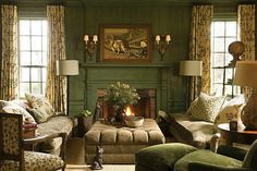 The library at Totier Creek Farm, a Virginia farmhouse built in 1760. Walls are glazed in Calke Green by Farrow & Ball. Sofas upholstered in gold and cream figured velvet. Lounge chair and ottoman covered in an overscaled Federal green chenille damask by Watts of Westminster. Linen curtains from Raoul Textiles.  Photo by Edward Addeo, from Barry Dixon Interiors.