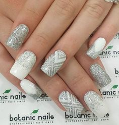 Here's a combination of styles you can do with a white nail (or false nail if you prefer) and silver lacquer. Full silver nails, just a splash of silver, V-shaped french tips and of course, the Chevron pattern.