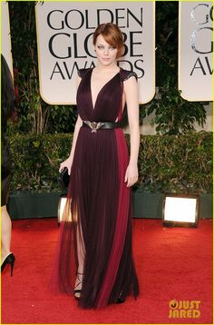 Emma Stone at the 2012 golden globes in a custom-made deep plum tulle siren gown with raspberry paneling side insert and strong embroidered shoulder from Lanvin